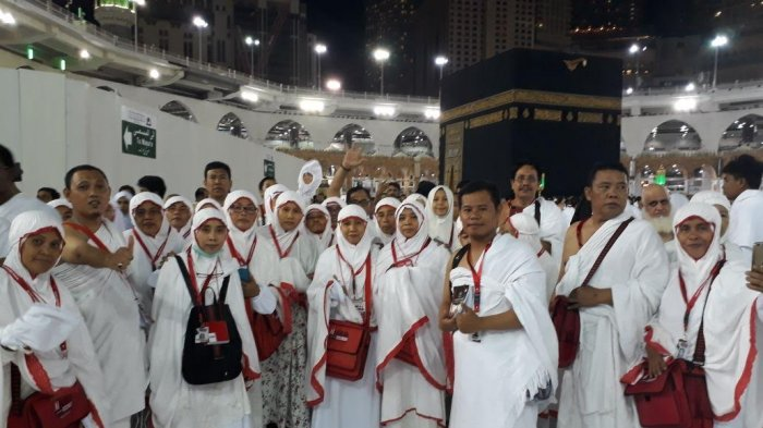 Jamaah Mengenakan Pakaian Ihram, sumber : Tribun Timur - Tribunnews.com